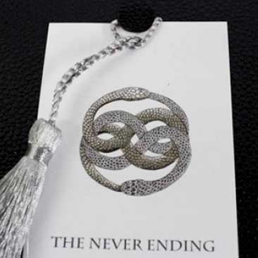 Black and White detail of embossed custom-designed entwined snake symbol for Neverending Story Wedding, Boston Event Planner, Boston Event Planning, Boston Event Stylist, Boston Event Styling