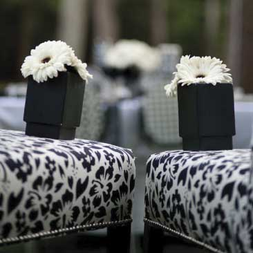 Black and White detail of upholstered chairs and flowerpots from an outdoor wine tasting event, Boston Event Planner, Boston Event Planning, Boston Event Stylist, Boston Event Styling