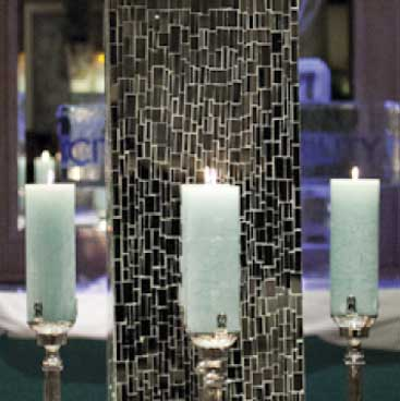 Blue detail of mirrored column surrounded by pillar candles for a corporate holiday event, Boston Event Planner, Boston Event Planning, Boston Event Stylist, Boston Event Styling