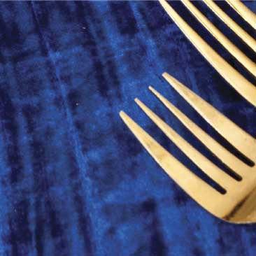 Blue detail of deep velvet tablecloth and gold flatware at a high tea fundraiser at Boston University, Boston Event Planner, Boston Event Planning, Boston Event Stylist, Boston Event Styling