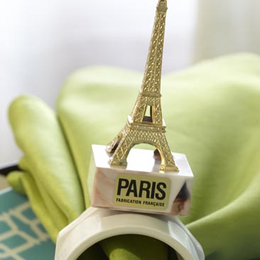 Green detail of an Eiffel Tower napkin holder from a travel company's celebration, Boston Event Planner, Boston Event Planning, Boston Event Stylist, Boston Event Styling