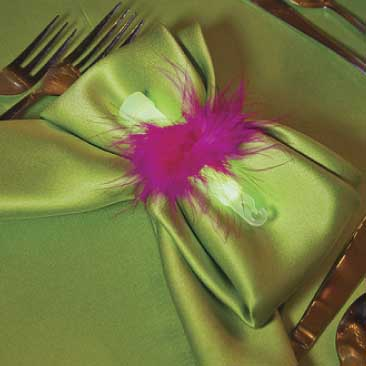 Green detail of a napkinholder made of pink feathers and a glow stick from a fashionista Bat Mitzvah, Boston Event Planner, Boston Event Planning, Boston Event Stylist, Boston Event Styling