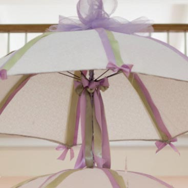 Purple detail of hanging umbrella centerpieces from a wine tasting bridal shower; Boston Event Planner, Boston Event Planning, Boston Event Stylist, Boston Event Styling