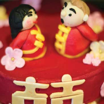Red detail of a cake top from a Vietnamese engagement party; Boston Event Planner, Boston Event Planning, Boston Event Stylist, Boston Event Styling