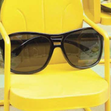 Yellow detail of mini metal lawn chairs holding a pair of sunglasses from a backyard birthday pool party; Boston Event Planner, Boston Event Planning, Boston Event Stylist, Boston Event Styling