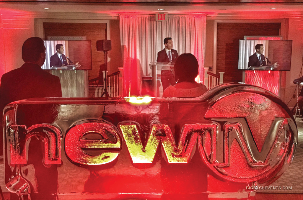 NewTV Media Awards Anniversary Gala, ice sculpture of the NewTV logo in front of a live presentation, Boston Event Planner, Boston Event Planning, Boston Event Stylist, Boston Event Styling