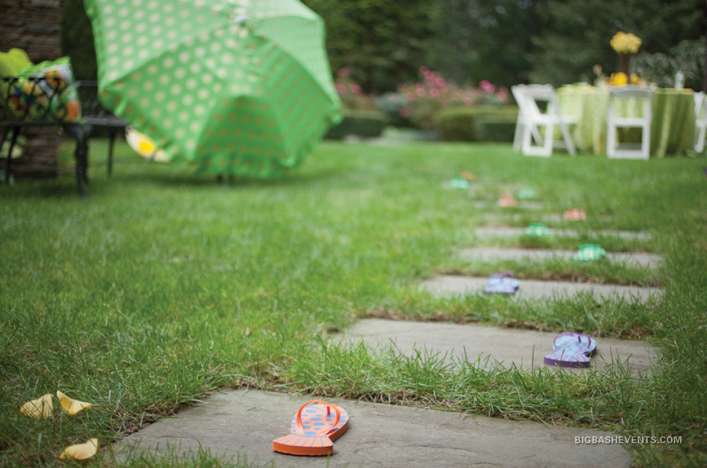 Splash! Birthday Pool Party: summer flipflops draw guests into the lush green backyard party; Boston Event Planner, Boston Event Planning, Boston Event Stylist, Boston Event Styling